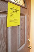 stock photo of eviction  - foreclosure notice on door of home focus of sign all information is fictitious - JPG