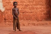 African Boy With Stick