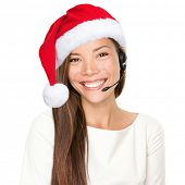 Christmas headset woman from telemarketing call center wearing red santa hat talking smiling isolate