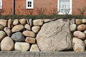 foto of fieldstone-wall  - The Frisian stone wall is a dry stone wall typical for Northern Germany - JPG
