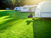 stock photo of motorhome  - Travel trailer camping in a morning light - JPG