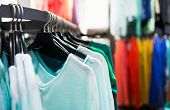 stock photo of casual wear  - Fashionable colorful clothes on hangers in the store - JPG
