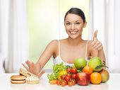 stock photo of hamburger  - healthy and junk food concept  - JPG