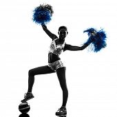 picture of cheerleader  - one young woman cheerleader cheerleading  silhouette studio on white background - JPG