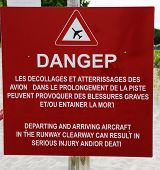 stock photo of west indies  - Danger sign next to runway at St Barts  Gustaf III Airport - JPG