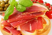 detail of spanish tapas with smoked ham