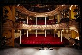 picture of stage theater  - View of an empty theatre with red seats and balcony - JPG