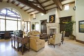 image of hacienda  - View of spacious living room with beamed ceiling at home - JPG