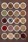 picture of wiccan  - Medicinal herb selection also used in witches magical potions over brown lokta paper background with titles - JPG