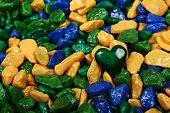 picture of malachite  - Green malachite heart on colored stones background   - JPG