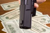 stock photo of glock  - Robbery with the use of a gun - JPG