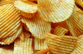 stock photo of crip  - Detailed view of spicy fried potato chips - JPG