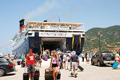 SKOPELOS, GREECE - JUNE 24, 2013: Hellenic Seaways ferry Express Pegasus disembarks passengers at Sk
