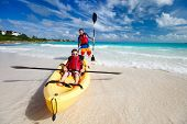 image of canoe boat man  - Father and son kayaking at tropical ocean - JPG