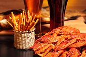 picture of crawfish  - Prepared crawfish, snacks and glasses of beer, close up