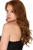 stock photo of bustiers  - Petite freckled redhead in a black corset - JPG