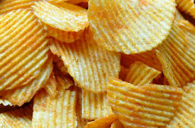 foto of crip  - Detailed view of spicy fried potato chips - JPG
