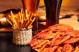 picture of crawdads  - Prepared crawfish, snacks and glasses of beer, close up ** Note: Shallow depth of field - JPG