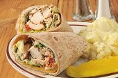 stock photo of sandwich wrap  - Chicken wrap sandwiches with potato salad on a rustic wooden table - JPG