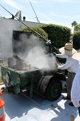 foto of boiling point  - Hot molten tar is melted to a boiling point then added to a roof to help glue down tar paper - JPG