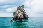stock photo of chums  - Tropical rock island against blue sky and sea Chum porn Thailand - JPG