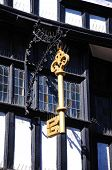image of nod  - Gold Key on the front of The House of the Golden Key also knows as the House of Nodding Gables along the High Street Tewkesbury Gloucestershire England UK Western Europe - JPG