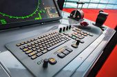 foto of acceleration  - Modern ship control panel with radar screen accelerator trackball and keyboard - JPG