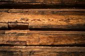 image of log fence  - Wooden wall from logs as a background texture - JPG