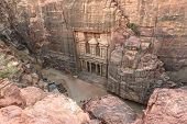 foto of treasury  - The Treasury in the Ancient city of Petra carved out of the rock Jordan as seen from the cliff - JPG