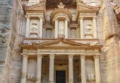 stock photo of treasury  - The Treasury in the Ancient city of Petra carved out of the rock Jordan - JPG