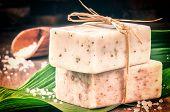 stock photo of bath sponge  - Natural handmade soap bars and sea salt - JPG