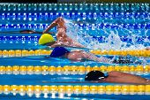 image of swim meet  - free style men competition in swimming pool - JPG