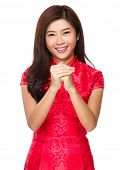 stock photo of cross-dress  - Chinese woman with celebrate gesture - JPG