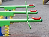 stock photo of seesaw  - Close up of colorful seesaw in playground - JPG