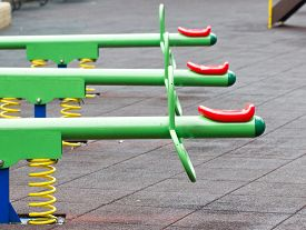 pic of seesaw  - Close up of colorful seesaw in playground - JPG