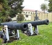 foto of cannon  - detail of two cannon in italian military museum - JPG