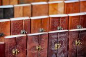 picture of stall  - Beautiful intricately detailed leatherwork on the bindings of these souvenir notebooks at a vendor - JPG