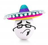 stock photo of sombrero  - Concept white egg with grinning face and sunglasses in a sombrero isolated on white - JPG