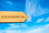 Wooden arrow sign pointing destination JOHANNESBURG poster