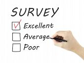 stock photo of performance evaluation  - choosing excellent on customer service evaluation form over white background - JPG