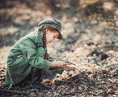 foto of bonfire  - little girl making a bonfire - JPG
