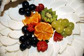 picture of fruit platter  - Fresh handmade cow cheese with fruits as gourmet specialities - JPG