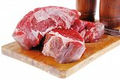picture of porterhouse steak  - fresh raw beef steak entrecote fillet ready to prepare on cut board with cutlery and castor isolated over white background - JPG