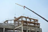 picture of heavy equipment operator  - Mobile crane is the heavy machine used to lifting heavy material at construction site - JPG