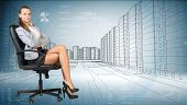 foto of crossed legs  - Businesslady sitting half turned in chair with crossed legs and looking at camera on cityscape background - JPG