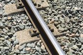 stock photo of train track  - Train tracks in a platform of station in a town - JPG
