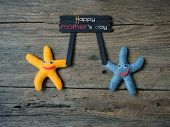 pic of i love you mom  - Happy mothers day with i love you mom message idea from colorful fabric starfish on wooden background abstract wooden texture mother - JPG