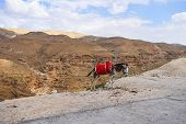 foto of donkey  - Lonely resting donkey on the view of mountain range - JPG