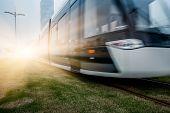 stock photo of high-speed train  - speeding train away from railway station - JPG