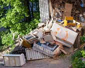 picture of dumpster  - Funny broken furniture trash pile at yard - JPG